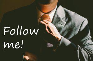 Businessman saying follow me
